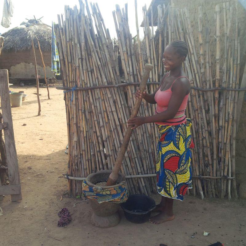 Girl pounding millet